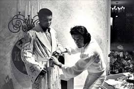 Elvis and Muhammad Ali with the robe that Elvis had specially made for him.