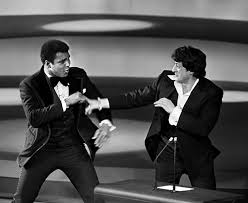 Muhammad Ali (L) sparring playfully with Sylvester Stallone in 1976