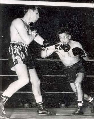 Charlie Fusari (L) decisions Joe Carkido (R) in 1950