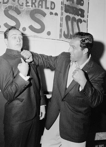 Actor Marlon Brando fooling around with Heavyweight Champion Rocky Marciano in 1955