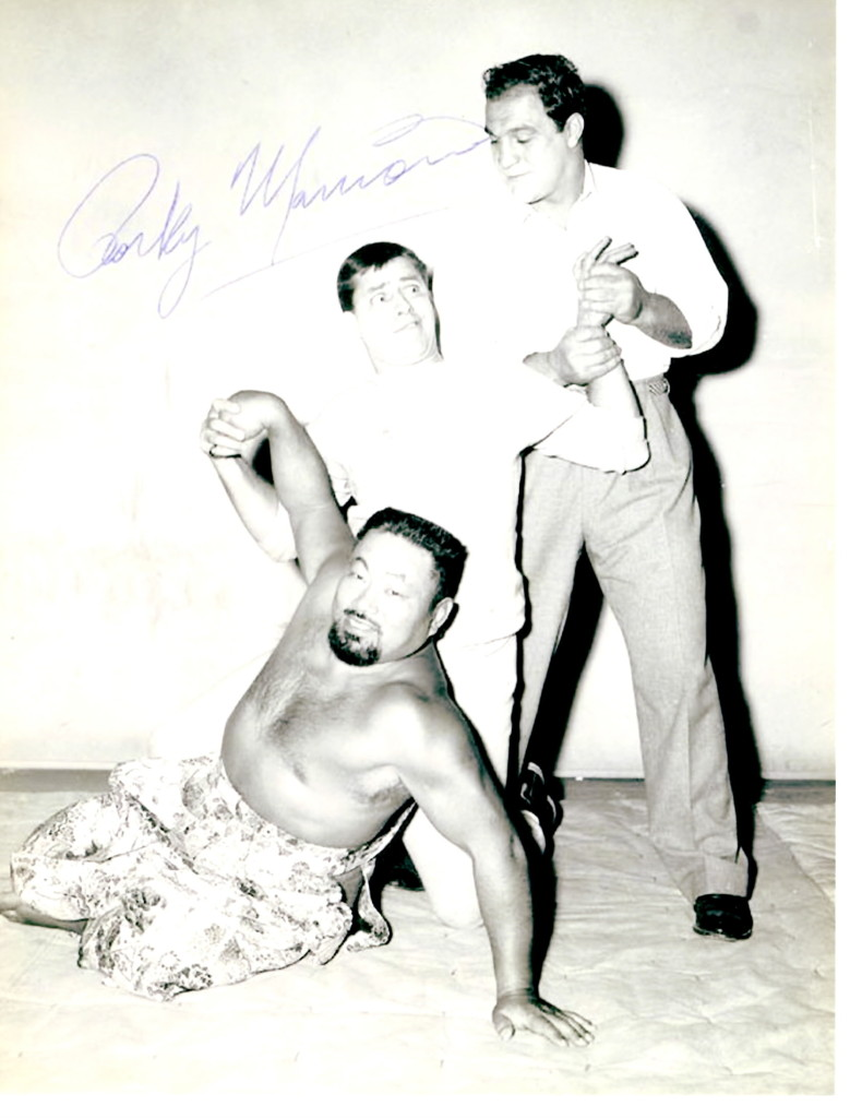 Jerry Lewis with a wrestler and Rocky Marciano