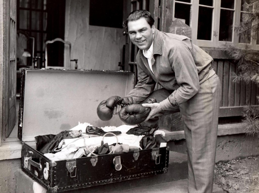 May 2, 1936. Former Heavyweight champion Max Schmeling unpacking his boxing gear after arriving at his training camp at the Na[anoch Country Cl;ub in Napanoch, New York to begin training and preparation for his upcoming June bout at Yankee Stadium against unbeaten Joe Louis.