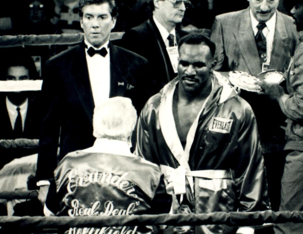 """World heavyweight Champion Evander """"The Real Deal"""" Holyfield with trainer Lou Duva and ring announcer Michael Buffer. *(PHOTO BY ALEX RINALDI)"""