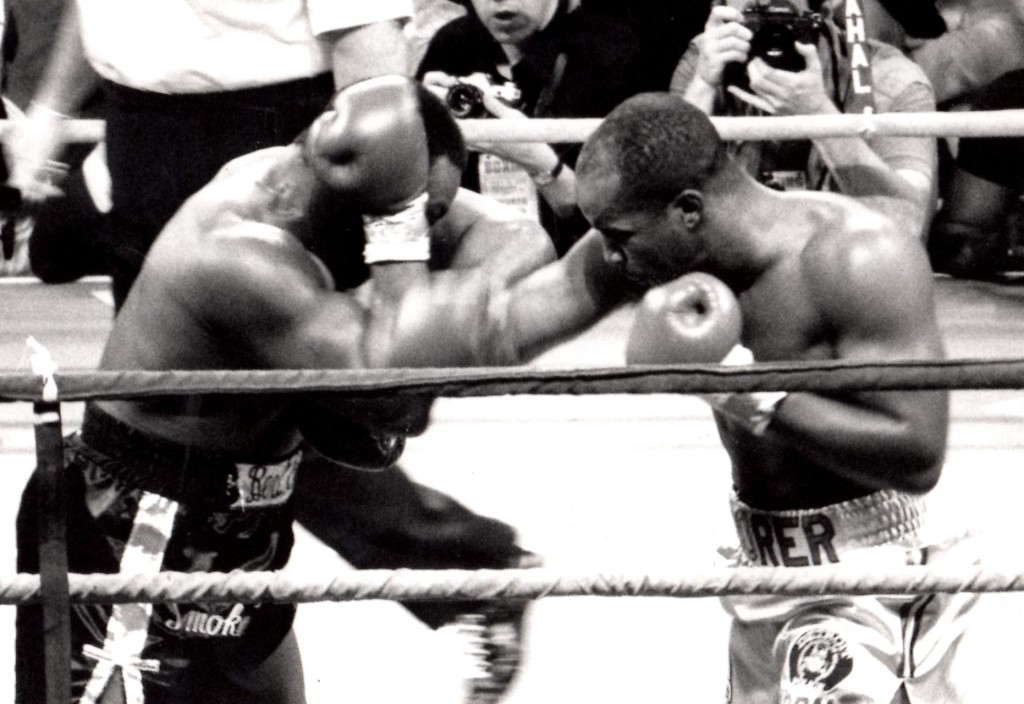 Michael Moorer (R) knocking out Bert Cooper in 1992 in Atlantic City, NJ * (PHOTO BY ALEX RINALDI)