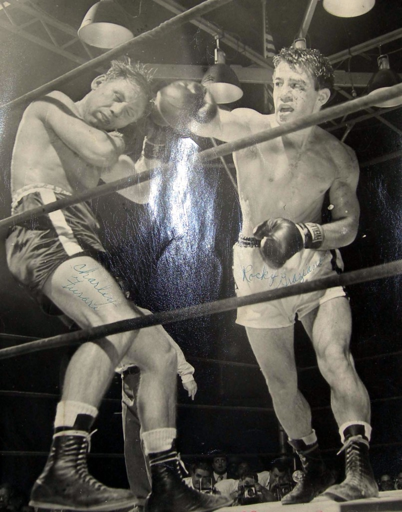 Charlie Fusari (L) and Rocky Graziano (R) battle each other