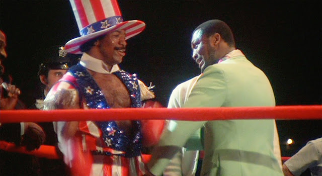 Apollo Creed (Carl Weathers) and Joe Frazier in Rocky film.