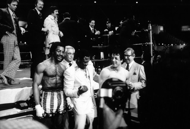 Carl Weathers, Joe Frazier and Sylvester Stallone on Rocky set.