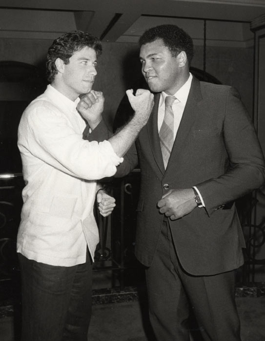 Muhammad Ali and John Travolta.