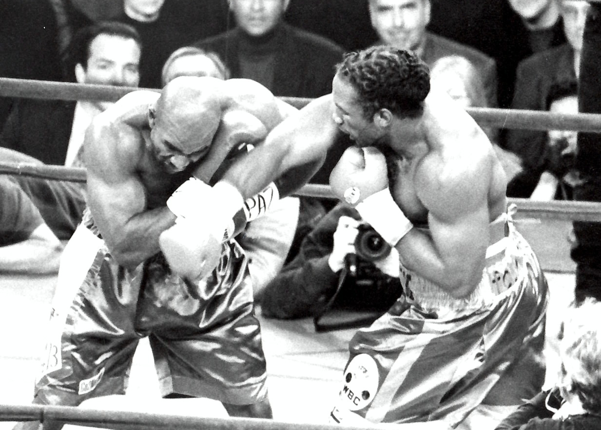 Lennox Lewis (R) nails Evander Holyfield in their fight for the Undisputed Heavwyweight Championship of the World on March 13, 1999 in Madison Square Garden, which ended in a draw. (PHOTO BY ALEX RINALDI)