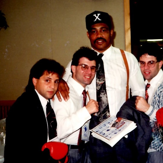 Gerard Rinaldi (L) with John Rinaldi, fomer Heavyweight Champion Ken Norton, and Alex Rinaldi in 1992