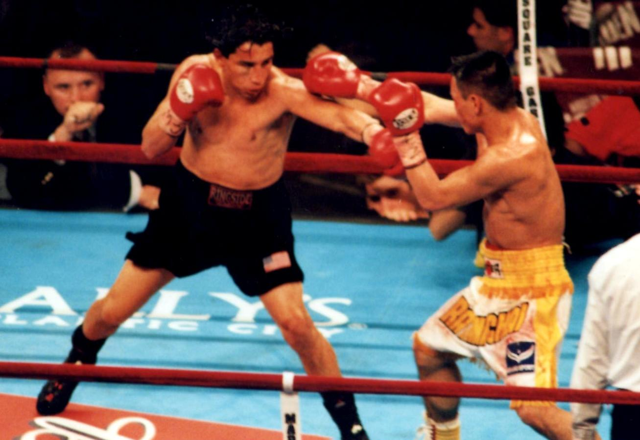 Former IBF Super Flyweight Champion Danny Romero stabs former WBO World bantamweight champion Ratanachai Sor Vorapin with a hard left in their bout on September 29, 2001, in New York's Madison Square Garden,. Lopez retired after the bout with an unbelievable record of 51-0-1! (PHOTO BY ALEX RINALDI)