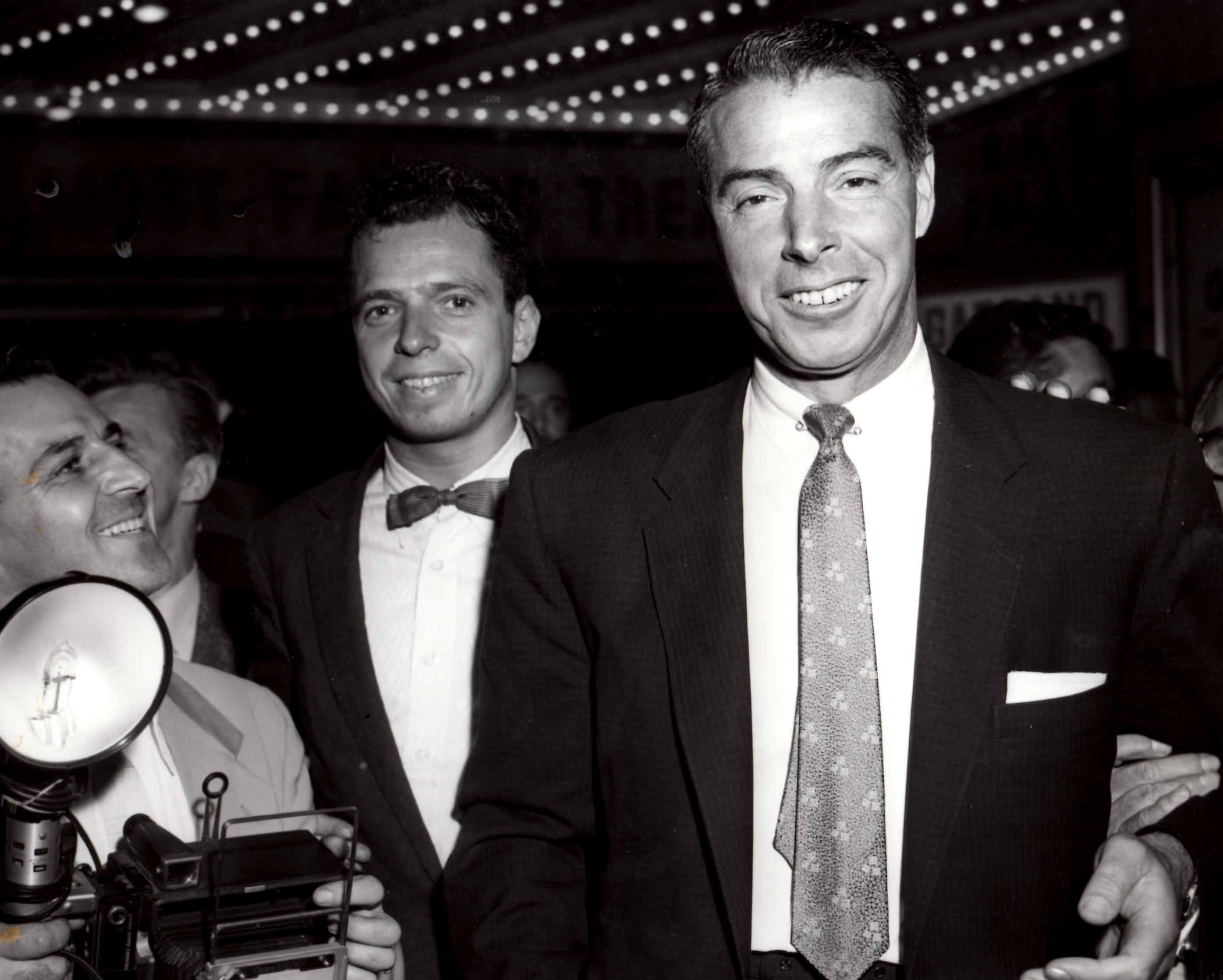 New York Yankee legend Joe DiMaggio coming out of Madison Square Garden after a fight.