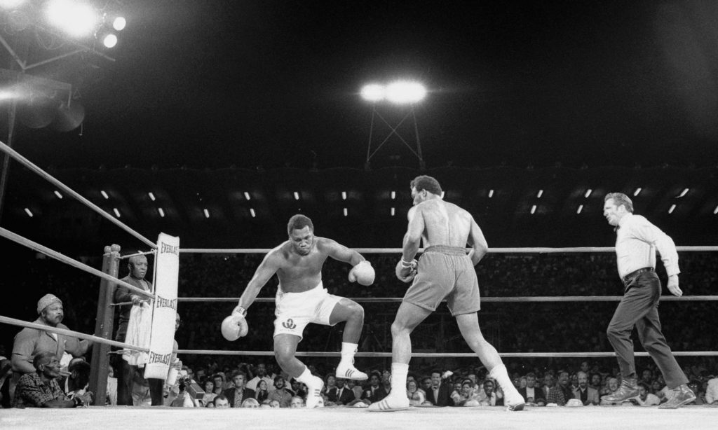 22 Jan 1973, Kingston, Jamaica --- Original caption: Joe Frazier topples backwards here during the second round of his title fight with George Foreman here on January 22nd. foreman won the fight in the second round after a series of knockdowns to take the heavyweight title away from Frazier. --- Image by © Bettmann/CORBIS