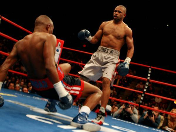 Jones-Trinidad - Jones knocks Felix to the canvas.
