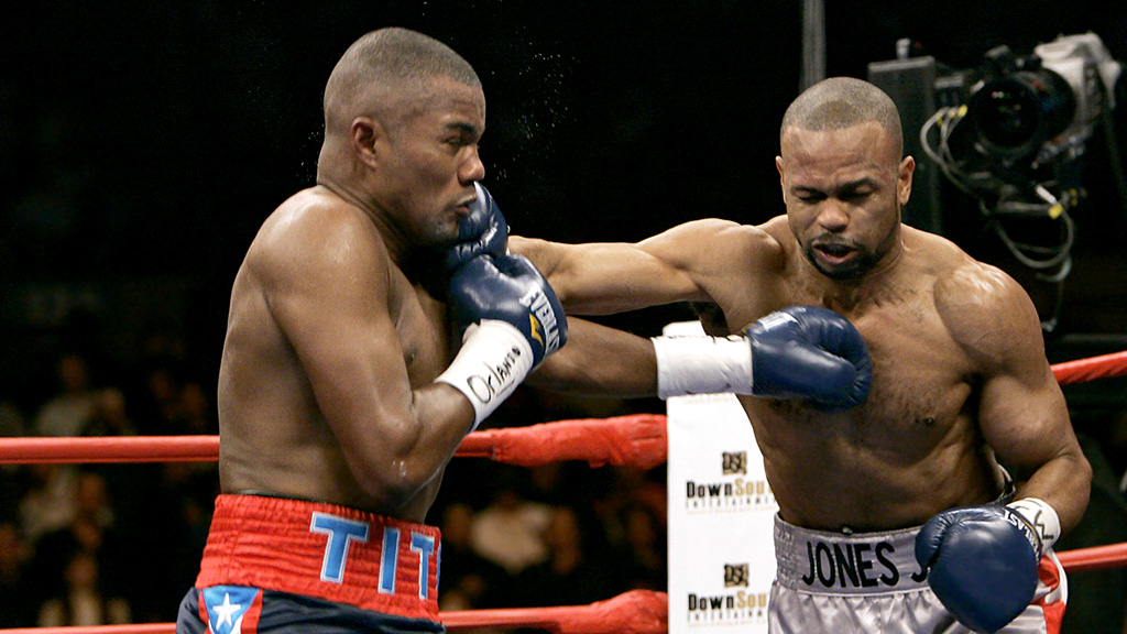 Jones-Trinidad - The two greats trade blows.