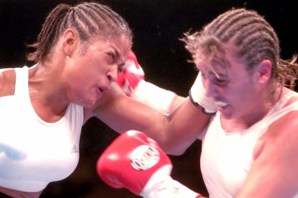 Laila Ali squaring off against Chrsity Martin on August 23, 2003. Ali won by KO 4.