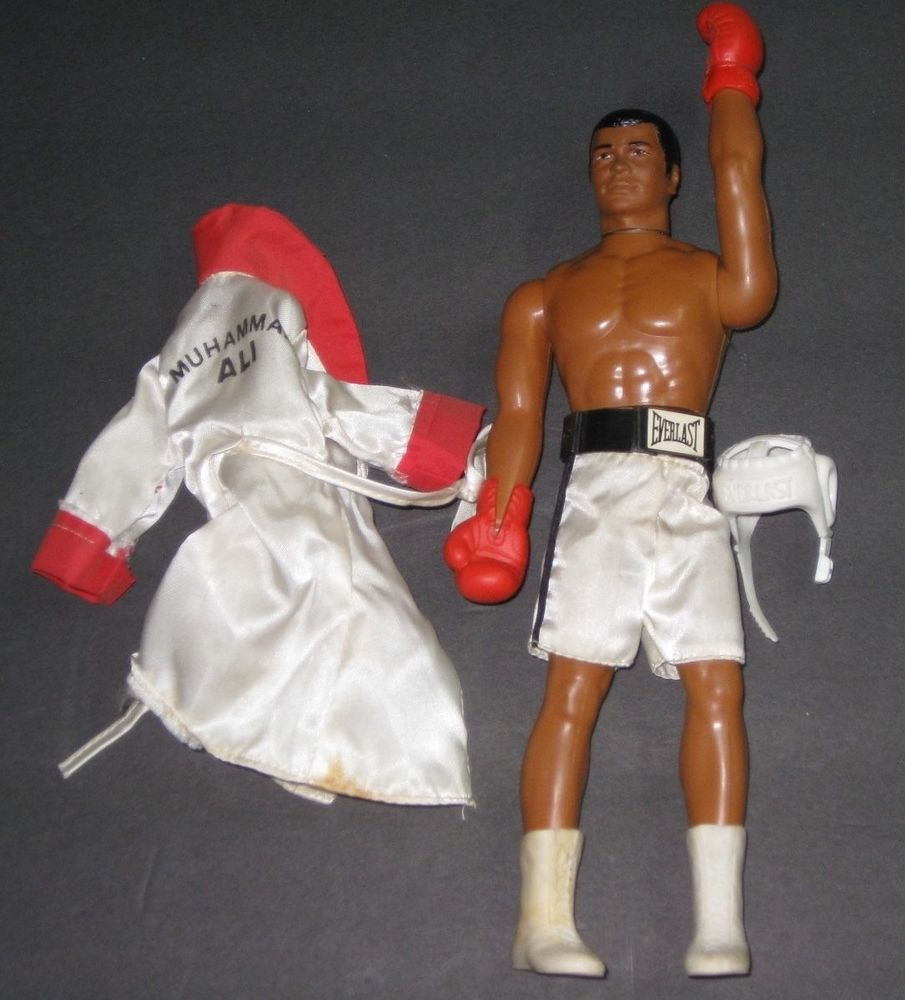 Muhammad Ali doll with robe and head gear. Muhammad Ali exhibtion poster. Muhammad Ali Monopoly Game. Muhammad Ali New boxing cartoon Ali. Muhammad Ali Richard Dunn slugs it out with Muhammad Ali. (CLICK PHOTO TO VIEW VIDEO)