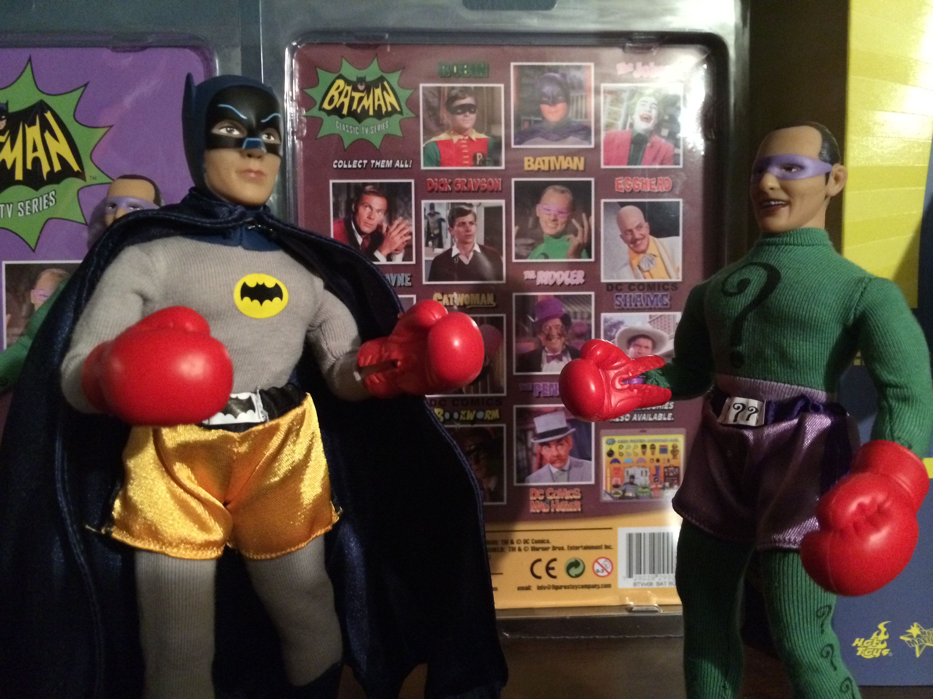 Batman boxing the Riddler dolls