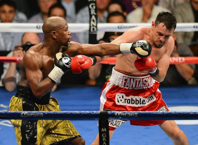 LAS VEGAS, NV - MAY 04: Floyd Mayweather Jr. (L) throws a left at Robert Guerrero during the fifth round of their WBC welterweight title bout at the MGM Grand Garden Arena on May 4, 2013 in Las Vegas, Nevada. Mayweather won by unanimous decision. (Photo by Ethan Miller/Getty Images)