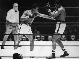 Ali (L) jabbing at Terrell (R). (CLICK PHOTO TO VIEW VIDEO OF FIGHT)
