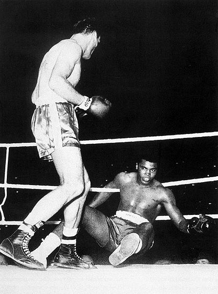 Cassius ClayHenry Cooper drops Cassius Clay down in the fourth round of their first bout. (CLICK ON PHOTO TO VIEW VIDEO OF FIGHT)