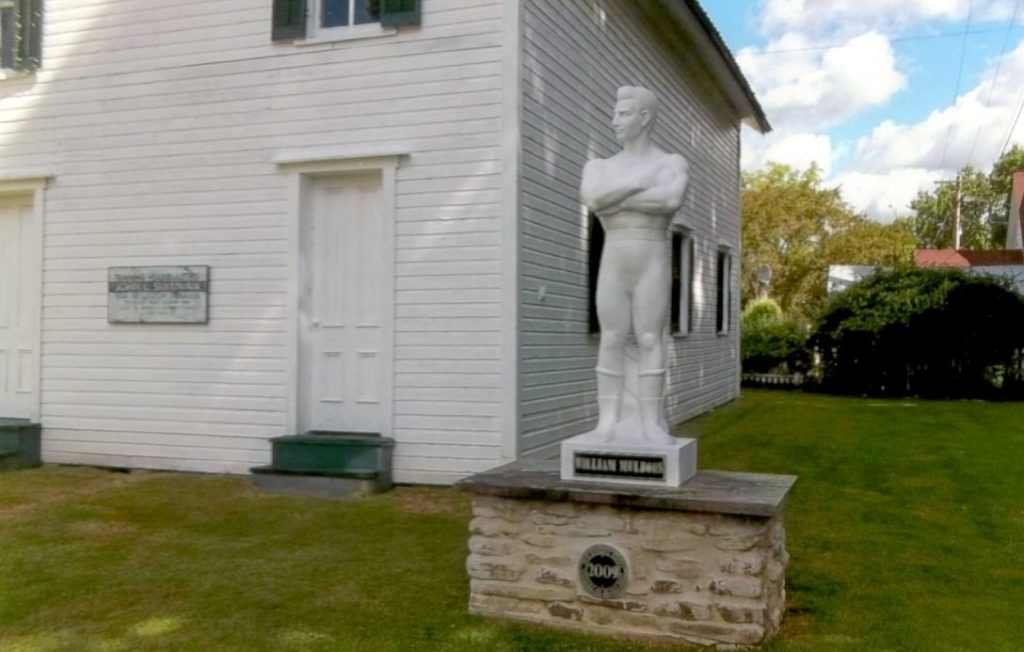John L. Sullivan's trainer and wrestling champion William Muldoon's statue in front of The Bare Knuckle Hall of Fame.