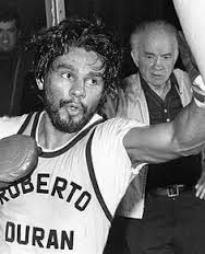 Roberto Duran training for the first Sugar Ray Leonard fight in 1980. Trainer Freddie Brown is looking on.