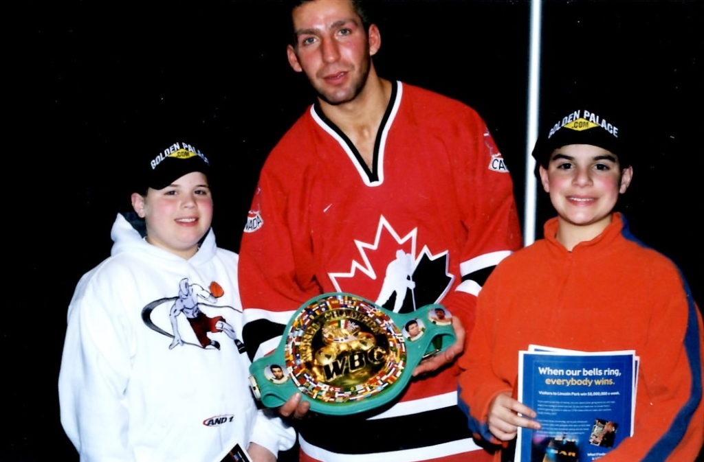 Ron John and Joseph Rinaldi with WBC World Super Middleweight Champion Eric Lucas on March 1, 2002 after Lucas decisioned Vinny Pazienza to retain his title at Foxwoods in Connecticut.
