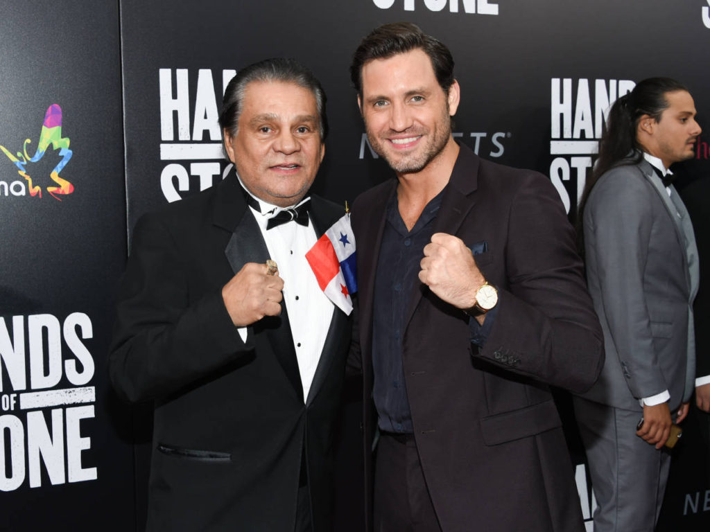 "Former professional boxer Roberto Duran, left, and actor Edgar Ramirez, who plays Duran in the film, pose together at the U.S. premiere of ""Hands of Stone"" at the SVA Theatre on Monday, Aug. 22, 2016, in New York. (Photo by Evan Agostini/Invision/AP)"