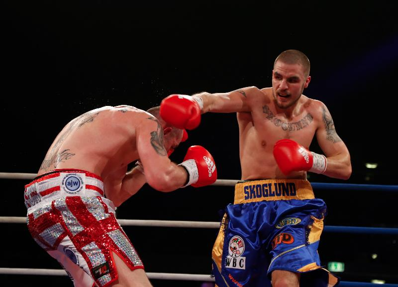 Erik Skoglund slugs away at Timy Shala
