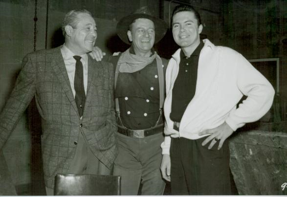 Former Heavyweight champion Max Baer (L) with actor John Wayne (C) and his son Max Baer Jr. (R)