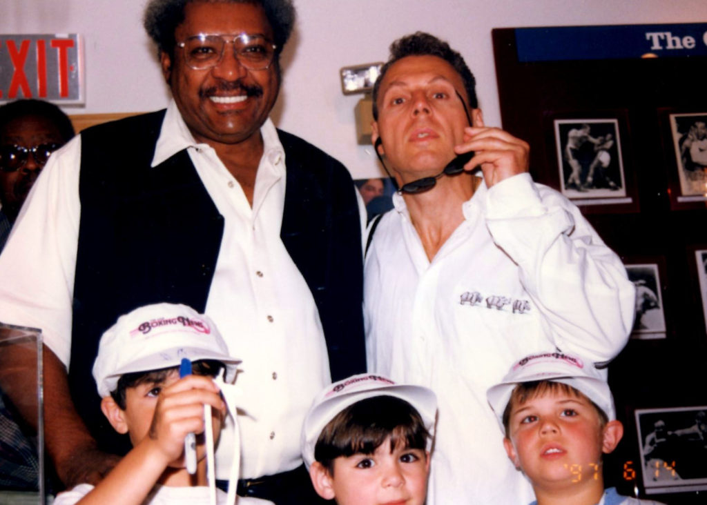 Promoter Don King with Joseph Rinaldi (bottom left) and Ron John Rinaldi (bottom right) at the International Boxing Hall of Fame. PHOTO BY ALEX RINALDI.