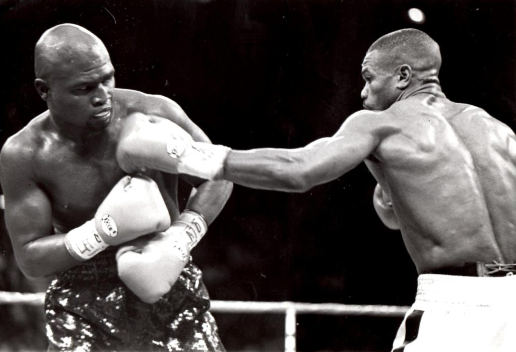Roy Jones Jr. (R) connecting with a jab to James Toney's jaw in their November 18, 1994 bout in Washington DC. for the IBF middleweight title (PHOTO BY ALEX RINALDI)