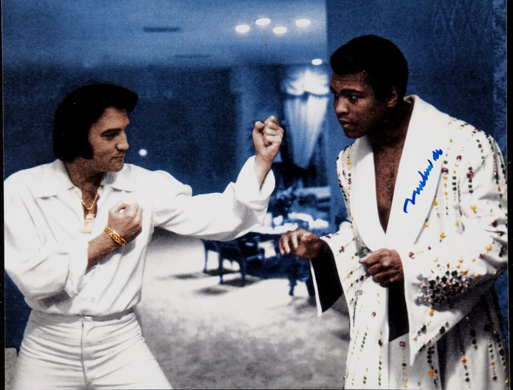 Elvis Presley L) and Muhammad Ali R) whom Elvis just surprised with a new tailored boxing robe