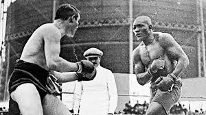 Johnson (R) winning the heavyweight title from champion Tommy Burns (L).
