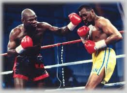 "Iran Barkley (L) nailing Thomas ""Hit Man"" Hearns (R) with a left hook en route to capturing the WBA World Light Heavyweight title on March 20, 1992."