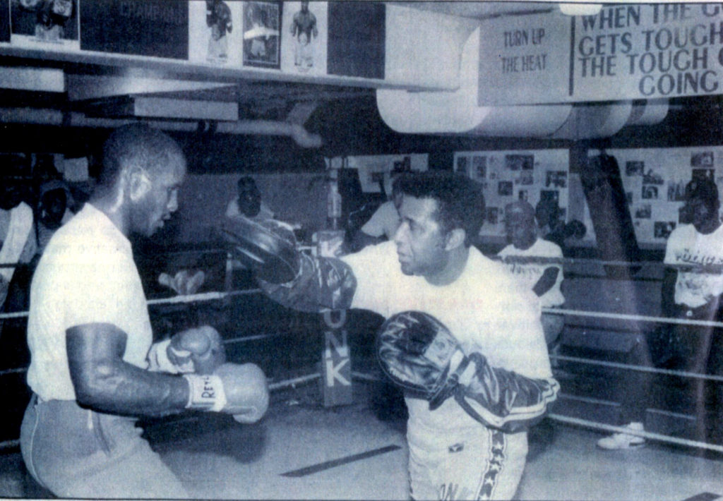 "Michael Moorer (L) working out with KRONK trainer Emanuel ""Manny"" Steward"
