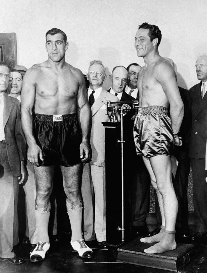 Carnera and Baer at their weigh-in