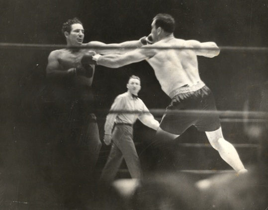 Primo Carnera and Max Baer trade hard jabs.