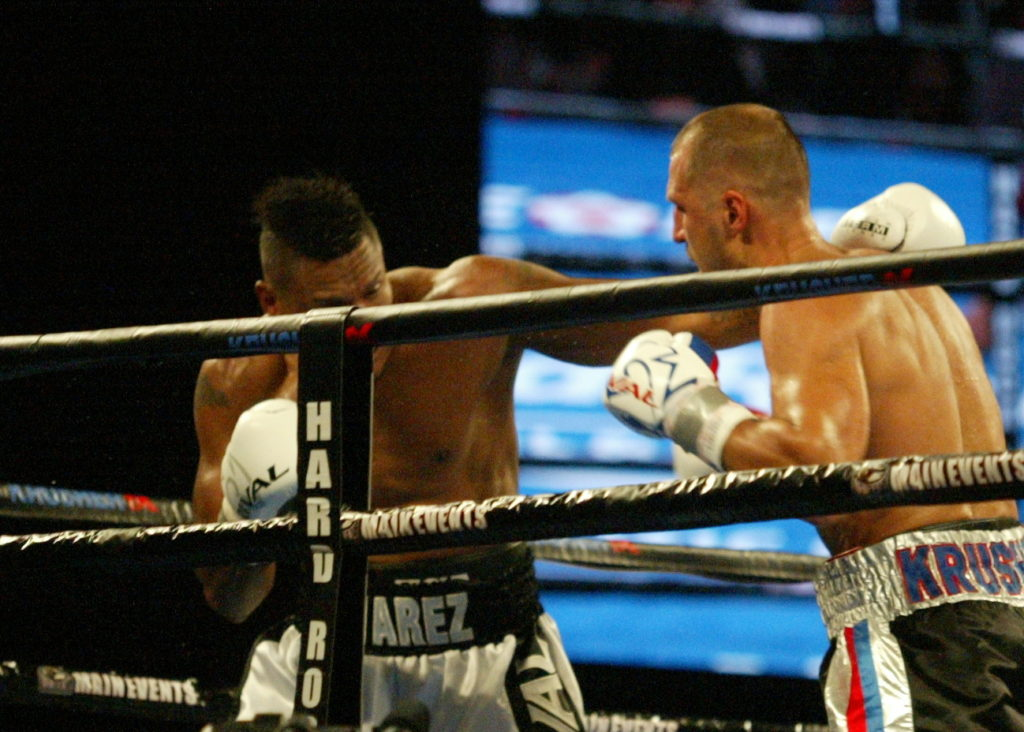 Alvarez (L) and Kovalev (R) both trade leather at each other.