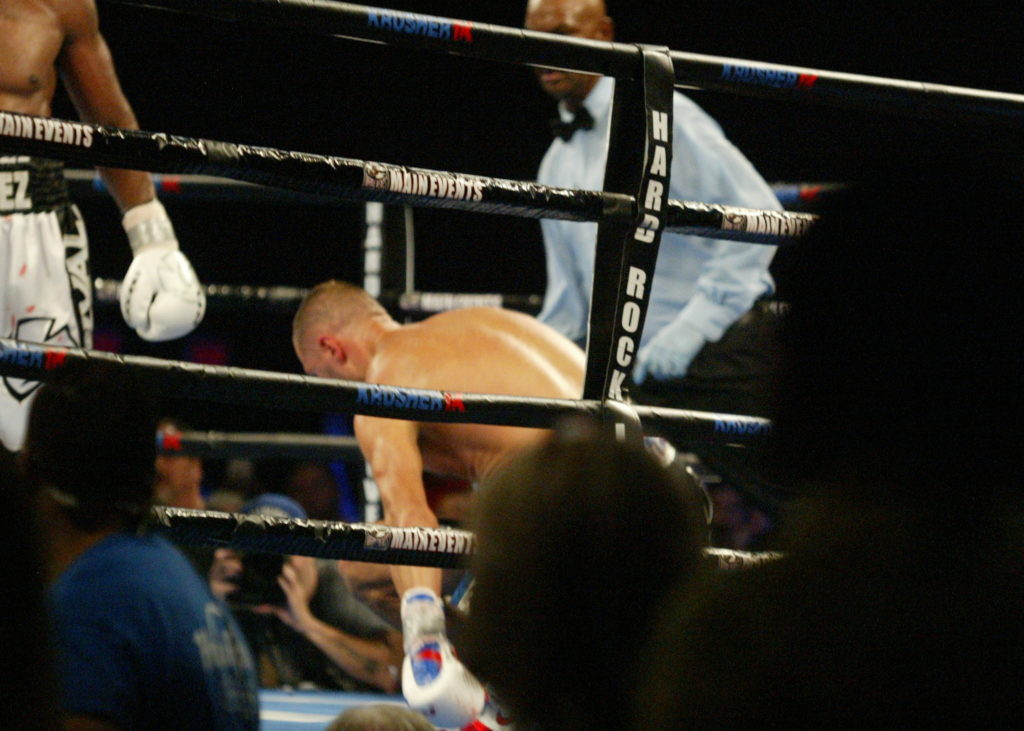 Kovalev (R) nails Alvarez (L) with a hard left.