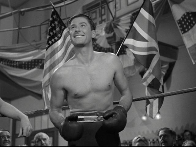 Errol Flynn Boxing smiling in gym.