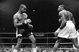 Carlos De Leon (left, battling Johnny Nelson)
