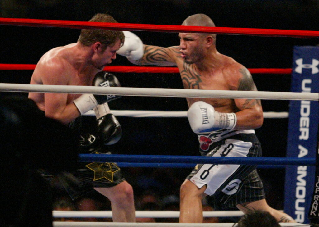 Miguel Cotto (R) landing a right against reigning WBO Super Welterweight Champion Yuri Foreman at New York's Yankee Stadium where Cotto won by KO on June 5, 2010.