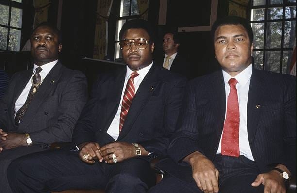 Joe Frazier, Larry Holmes, and Muhammad Ali.