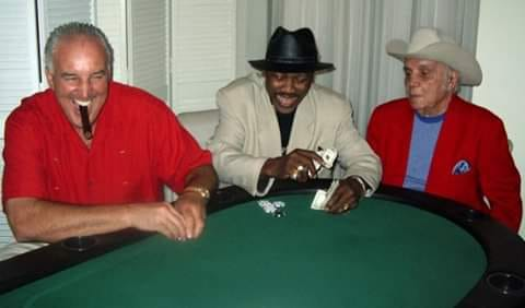 Gerry Cooney, Joe Frazier, and Jake LaMotta playing poker.