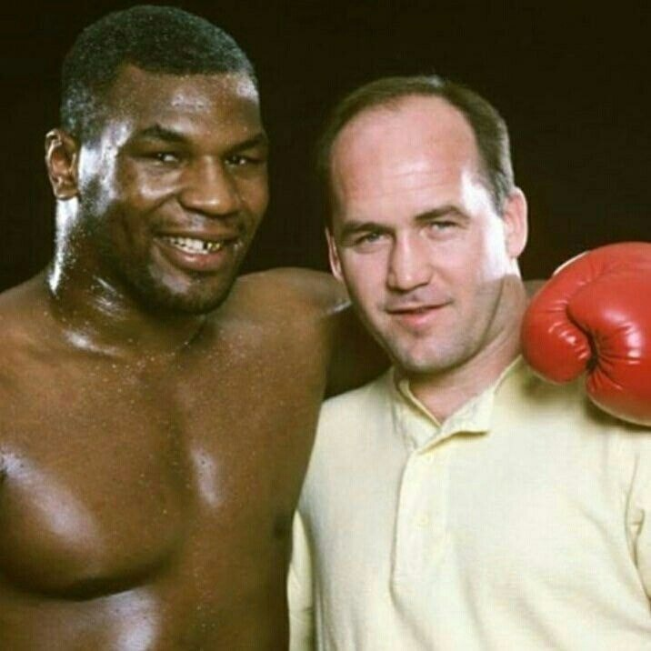 Mike Tyson with trainer Kevin Rooney in 1986.