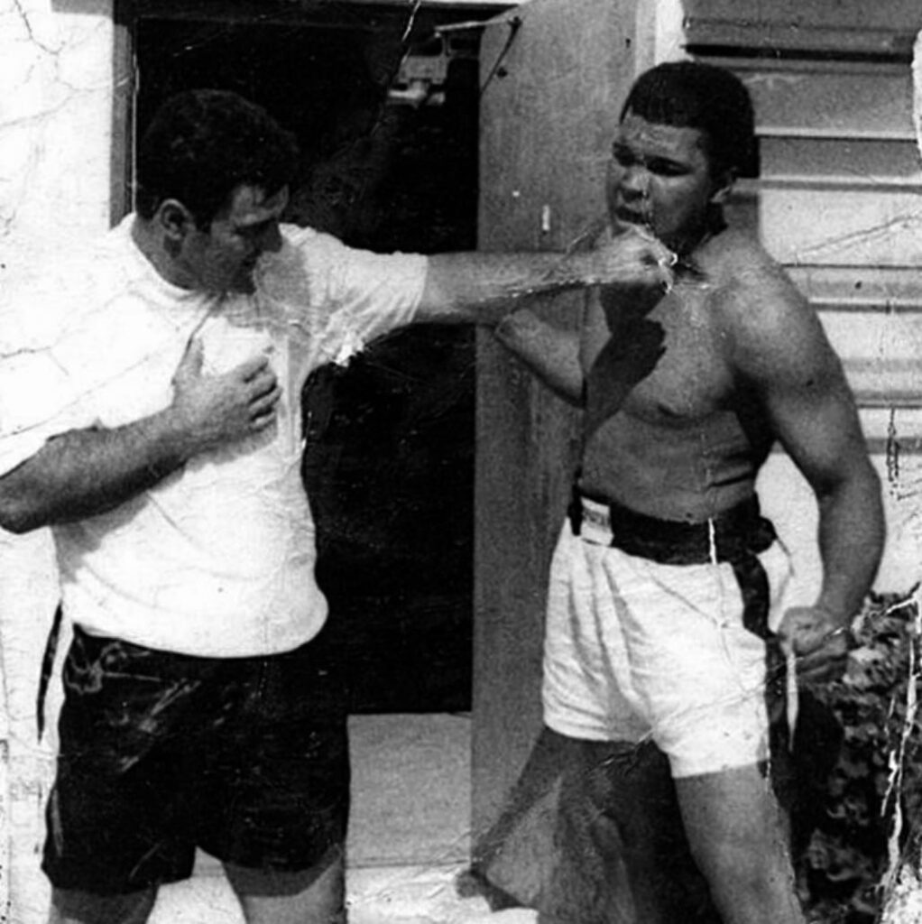 Former Heavyweight Champion Rocky Marciano with Muhammad Ali.