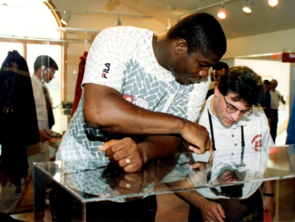 "Heavyweight Champion Riddick ""Big Daddy"" Bowe showing John Rinaldi some of the artifacts on display at the Boxing Hall of Fame."