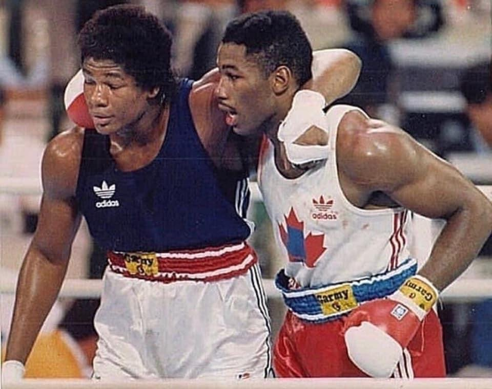 Future Heavyweight champions Riddick Bowe and Lennox Lewis embrace each other after Lewis won the Gold Medal and Bowe won the Silver medal in the 1988 Olympic Games in Seou, Korea.
